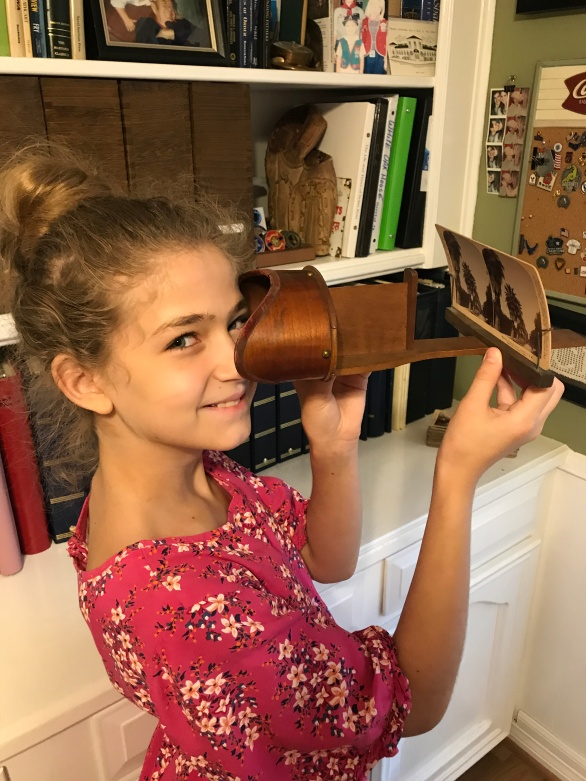 My daughter Natalie looks at a Stereoscopic card of Magnolia Avenue dated 1898